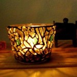 Smashed coloured glass on clear glass tea light (votive) candle holder.